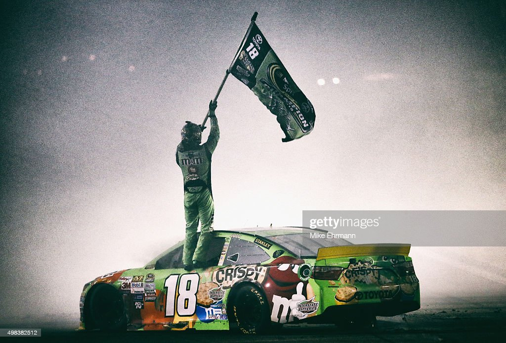 Kyle Busch, driver of the #18 M&M's Crispy Toyota, celebrates winning the series championship and the NASCAR Sprint Cup Series Ford EcoBoost 400 at Homestead-Miami Speedway on November 22, 2015 in Homestead, Florida.