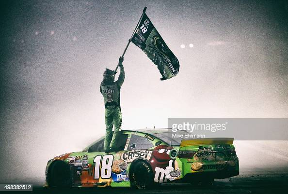 Kyle Busch driver of the MM's Crispy Toyota celebrates winning the series championship and the NASCAR Sprint Cup Series Ford EcoBoost 400 at...