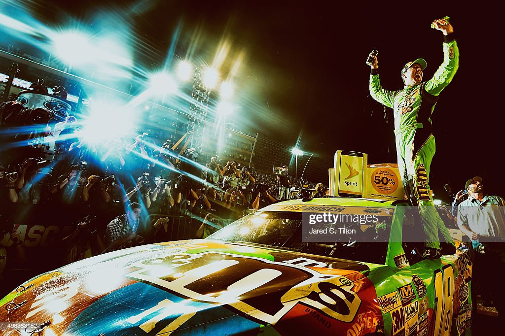 Kyle Busch, driver of the #18 M&M's Crispy Toyota, celebrates winning the series championship in Victory Lane after the NASCAR Sprint Cup Series Ford EcoBoost 400 at Homestead-Miami Speedway on November 22, 2015 in Homestead, Florida.