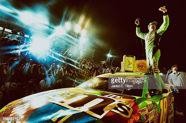 Kyle Busch driver of the MM's Crispy Toyota celebrates winning the series championship in Victory Lane after the NASCAR Sprint Cup Series Ford...