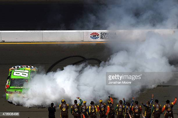 Kyle Busch driver of the MM's Crispy Toyota celebrates with a burnout after winning the NASCAR Sprint Cup Series Toyota/Save Mart 350 at Sonoma...