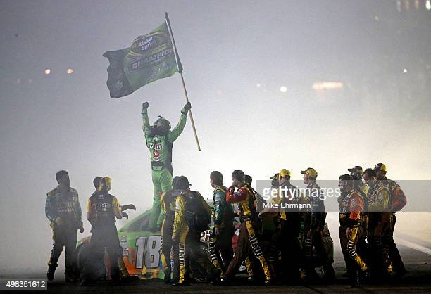 Kyle Busch driver of the MM's Crispy Toyota celebrates with his crew after winning the series championship and the NASCAR Sprint Cup Series Ford...