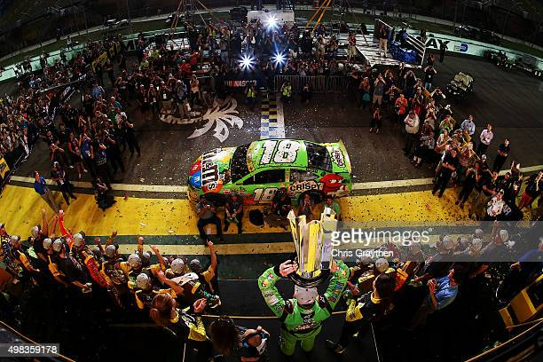 Kyle Busch driver of the MM's Crispy Toyota celebrates with his son Brexton and wife Samantha in Victory Lane after winning the series championship...