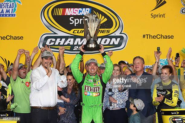 Kyle Busch driver of the MM's Crispy Toyota celebrates with the trophy in Victory Lane after winning the series championship and the NASCAR Sprint...