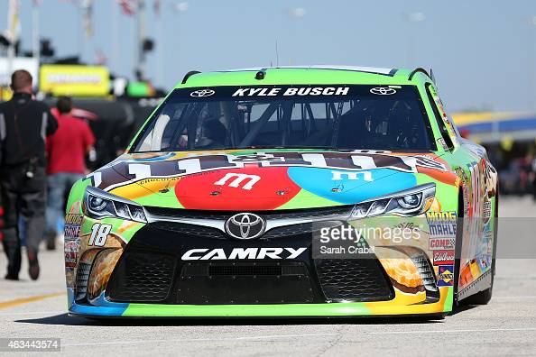 Kyle Busch driver of the MM's Crispy Toyota drives through the garage area during practice for the 57th Annual Daytona 500 at Daytona International...