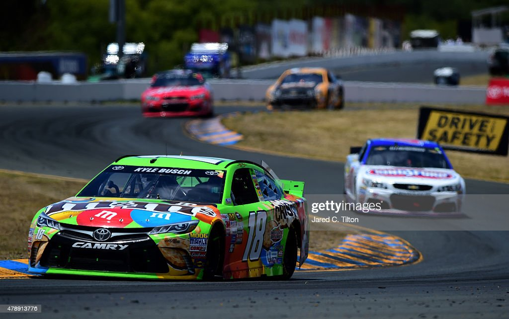 Kyle Busch driver of the MM's Crispy Toyota leads a pack of cars during the NASCAR Sprint Cup Series Toyota/Save Mart 350 at Sonoma Raceway on June...