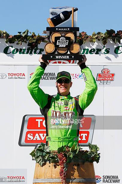 Kyle Busch driver of the MM's Crispy Toyota poses with the trophy after winning the NASCAR Sprint Cup Series Toyota/Save Mart 350 at Sonoma Raceway...