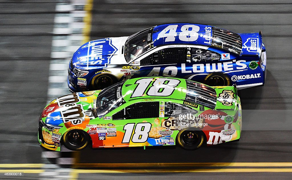 <a gi-track='captionPersonalityLinkClicked' href=/galleries/search?phrase=Kyle+Busch&family=editorial&specificpeople=211123 ng-click='$event.stopPropagation()'>Kyle Busch</a>, driver of the #18 M&M's Crispy Toyota, races <a gi-track='captionPersonalityLinkClicked' href=/galleries/search?phrase=Jimmie+Johnson+-+Nascar+Race+Driver&family=editorial&specificpeople=171519 ng-click='$event.stopPropagation()'>Jimmie Johnson</a>, driver of the #48 Lowe's Chevrolet, during the NASCAR Sprint Cup Series Budweiser Duel 2 at Daytona International Speedway on February 19, 2015 in Daytona Beach, Florida.