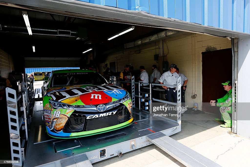 Kyle Busch driver of the MM's Crispy Toyota waits as his car goes through technical inspection prior to qualifying for the NASCAR Sprint Cup Series...