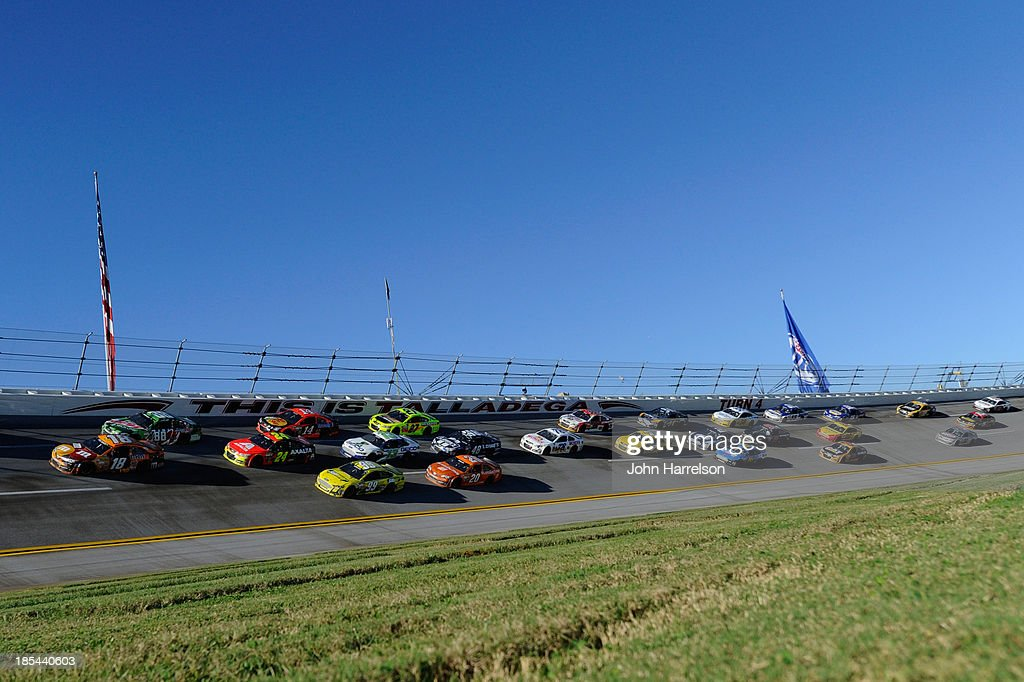 Kyle Busch, driver of the #18 M&M's Halloween Toyota, and Dale Earnhardt Jr., driver of the #88 Mountain Dew / XBox One Chevrolet, lead the field during the NASCAR Sprint Cup Series Camping World RV Sales 500 at Talladega Superspeedway on October 20, 2013 in Talladega, Alabama.