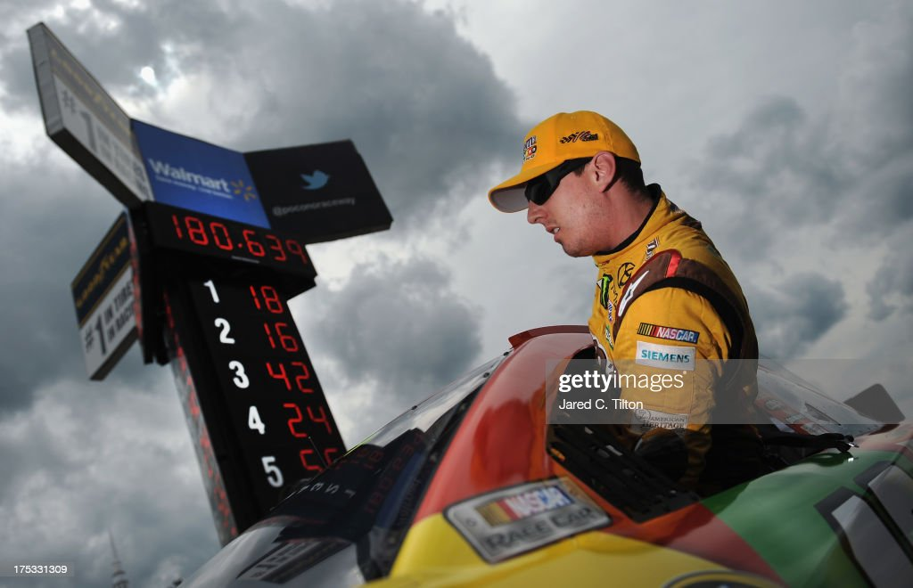 <a gi-track='captionPersonalityLinkClicked' href=/galleries/search?phrase=Kyle+Busch&family=editorial&specificpeople=211123 ng-click='$event.stopPropagation()'>Kyle Busch</a>, driver of the #18 M&M's Peanut Butter Toyota, climbs out of his car during qualifying for the NASCAR Sprint Cup Series GoBowling.com 400 at Pocono Raceway on August 2, 2013 in Long Pond, Pennsylvania.