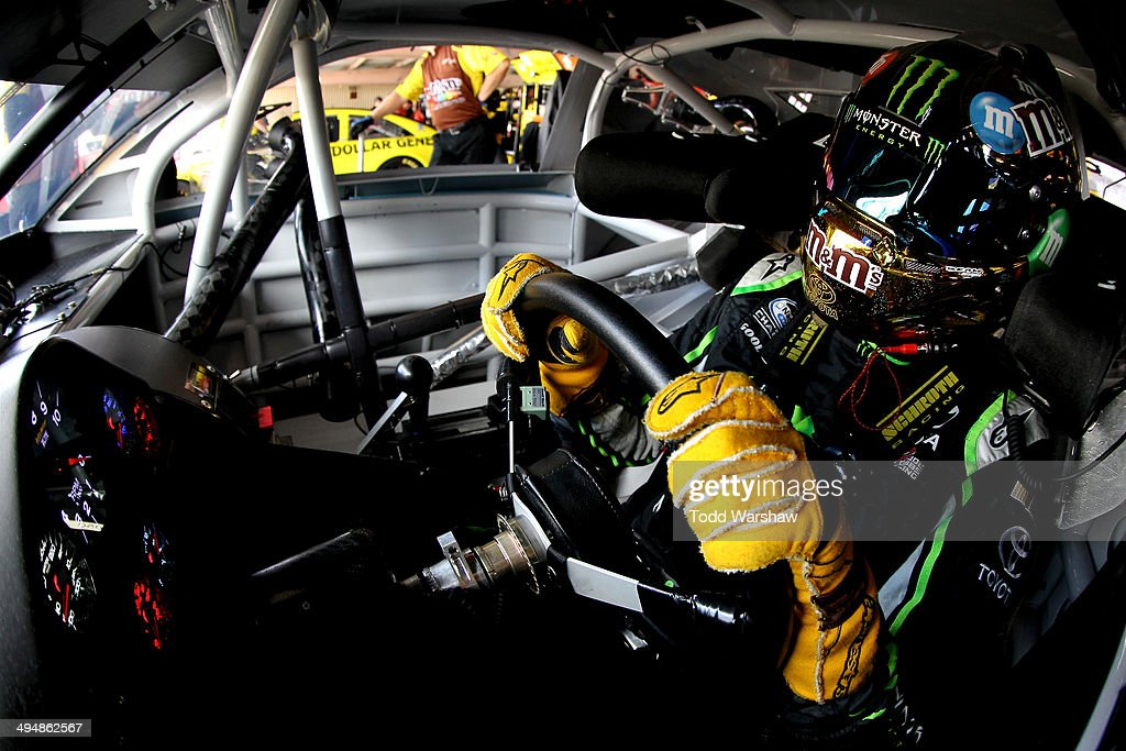 <a gi-track='captionPersonalityLinkClicked' href=/galleries/search?phrase=Kyle+Busch&family=editorial&specificpeople=211123 ng-click='$event.stopPropagation()'>Kyle Busch</a>, driver of the #18 M&M's Peanut Butter Toyota, sits in his car during practice for the NASCAR Sprint Cup Series FedEx 400 Benefiting Autism Speaks at Dover International Speedway on May 31, 2014 in Dover, Delaware.