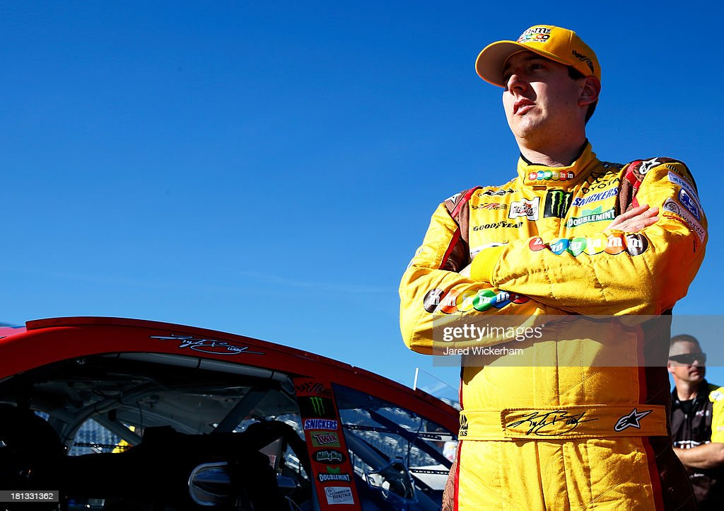 <a gi-track='captionPersonalityLinkClicked' href=/galleries/search?phrase=Kyle+Busch&family=editorial&specificpeople=211123 ng-click='$event.stopPropagation()'>Kyle Busch</a>, driver of the #18 M&M's Peanut Butter Toyota, stands by his car after qualifying for the NASCAR Sprint Cup Series Sylvania 300 at New Hampshire Motor Speedway on September 20, 2013 in Loudon, New Hampshire.