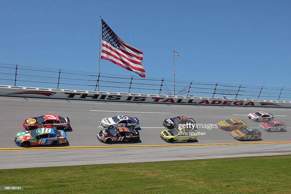 Kyle Busch, driver of the #18 M&M's Pretzel Toyota, and Austin Dillon, driver of the #3 Bass Pro Shops Chevrolet, lead a pack of cars during the NASCAR Sprint Cup Series Aaron's 499 at Talladega Superspeedway on May 4, 2014 in Talladega, Alabama.