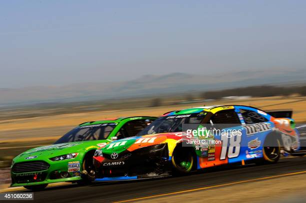Kyle Busch driver of the MM's Pretzel Toyota races Ricky Stenhouse Jr driver of the EcoPower Oil Ford during the NASCAR Sprint Cup Series Toyota/Save...