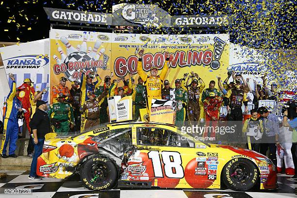 Kyle Busch driver of the MM's Red Nose Toyocta celebrates after winning the NASCAR Sprint Cup Series Go Bowling 400 at Kansas Speedway on May 7 2016...