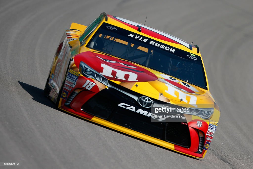 Kyle Busch, driver of the #18 M&M's Red Nose Toyota, drives during practice for the NASCAR Sprint Cup Series Go Bowling 400 at Kansas Speedway on May 6, 2016 in Kansas City, Kansas.