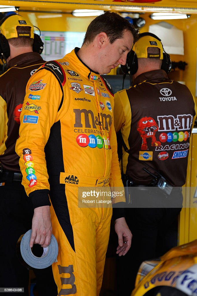 <a gi-track='captionPersonalityLinkClicked' href=/galleries/search?phrase=Kyle+Busch&family=editorial&specificpeople=211123 ng-click='$event.stopPropagation()'>Kyle Busch</a>, driver of the #18 M&M's Red Nose Toyota, looks at his car during practice for the NASCAR Sprint Cup Series Go Bowling 400 at Kansas Speedway on May 6, 2016 in Kansas City, Kansas.