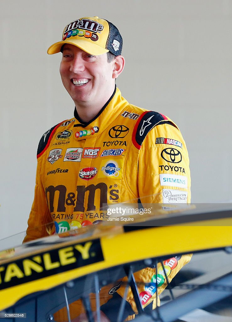 <a gi-track='captionPersonalityLinkClicked' href=/galleries/search?phrase=Kyle+Busch&family=editorial&specificpeople=211123 ng-click='$event.stopPropagation()'>Kyle Busch</a>, driver of the #18 M&M's Red Nose Toyota, looks on during practice for the NASCAR Sprint Cup Series Go Bowling 400 at Kansas Speedway on May 6, 2016 in Kansas City, Kansas.