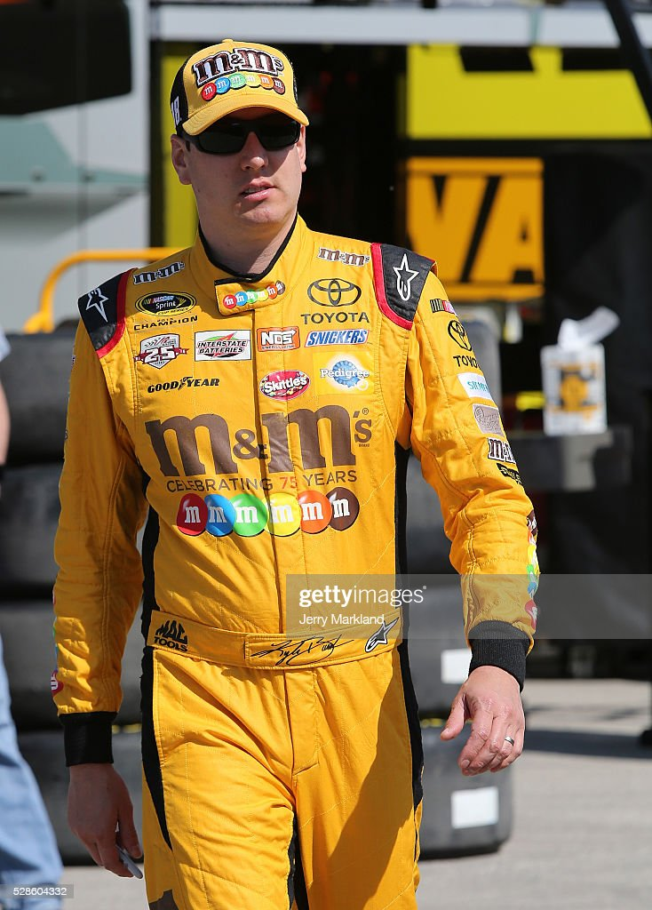 Kyle Busch, driver of the #18 M&M's Red Nose Toyota, looks on during practice for the NASCAR Sprint Cup Series Go Bowling 400 at Kansas Speedway on May 6, 2016 in Kansas City, Kansas.