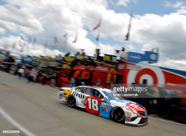 Kyle Busch driver of the MM's Red White Blue Toyota drives through the garage during practice for the Monster Energy NASCAR Cup Series CocaCola 600...