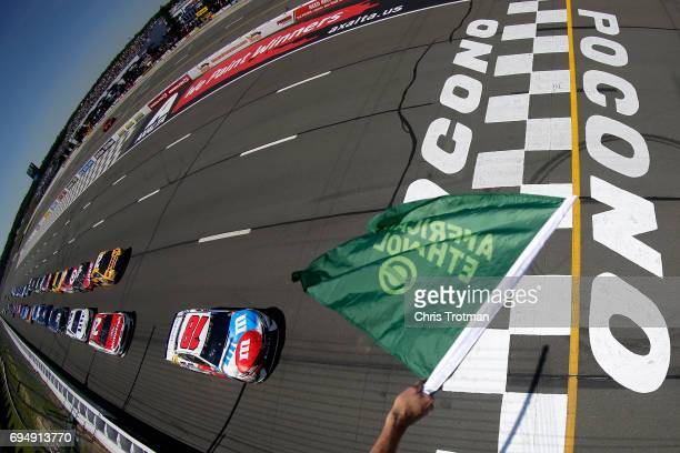 Kyle Busch driver of the MM's Red White Blue Toyota leads the field to the green flag to start the Monster Energy NASCAR Cup Series Axalta presents...