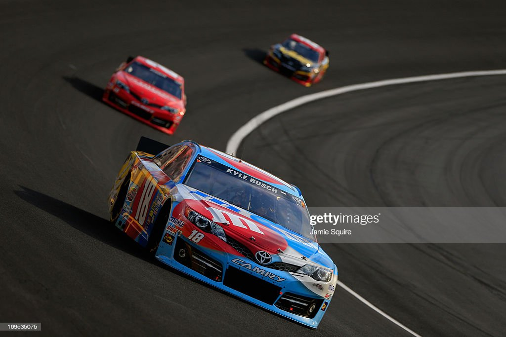 Kyle Busch driver of the MM's RedWhiteBlue MProve America Toyota leads a group of cars during the NASCAR Sprint Cup Series CocaCola 600 at Charlotte...