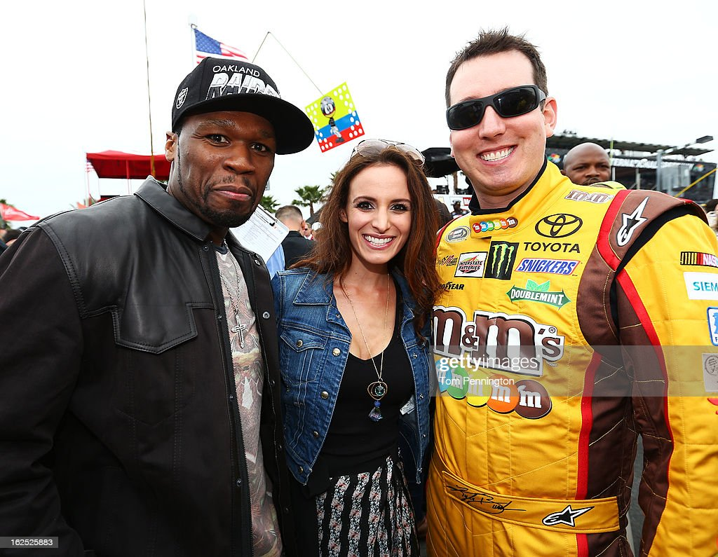 Kyle Busch, driver of the #18 M&M's Toyota, and his wife, Samantha Busch, meet with Curtis '50 Cent' Jackson before the start of the NASCAR Sprint Cup Series Daytona 500 at Daytona International Speedway on February 24, 2013 in Daytona Beach, Florida.