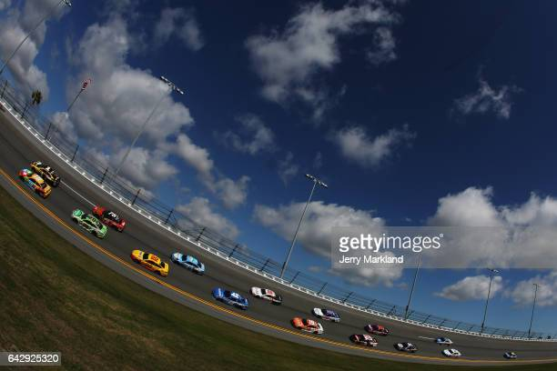 Kyle Busch driver of the MM's Toyota and Jamie McMurray driver of the McDonald's Big Mac Chevrolet lead a pack of cars during the weather delayed...