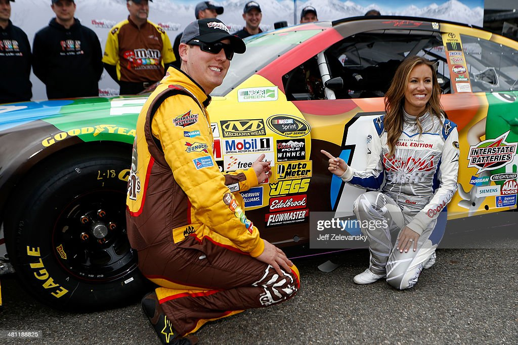 <a gi-track='captionPersonalityLinkClicked' href=/galleries/search?phrase=Kyle+Busch&family=editorial&specificpeople=211123 ng-click='$event.stopPropagation()'>Kyle Busch</a>, driver of the #18 M&M's Toyota, and Miss Coors Light Rachel Rupert pose with the Coors Light Pole Award after Busch qualified for the pole for the NASCAR Sprint Cup Series STP 500 at Martinsville Speedway on March 28, 2014 in Martinsville, Virginia.