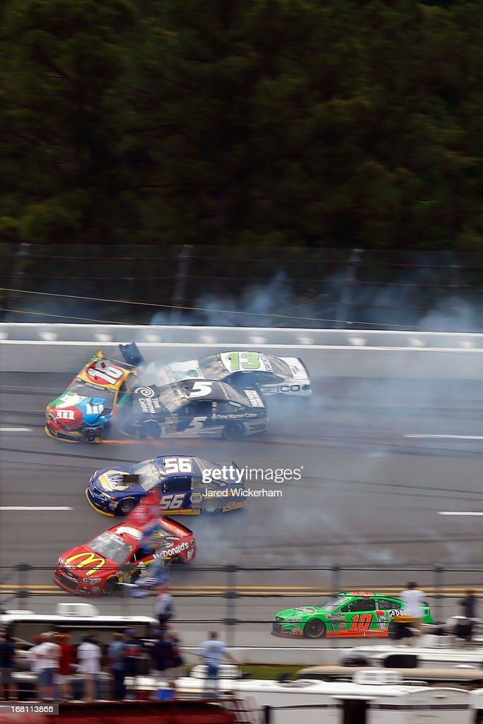 <a gi-track='captionPersonalityLinkClicked' href=/galleries/search?phrase=Kyle+Busch&family=editorial&specificpeople=211123 ng-click='$event.stopPropagation()'>Kyle Busch</a>, driver of the #18 M&M's Toyota, <a gi-track='captionPersonalityLinkClicked' href=/galleries/search?phrase=Casey+Mears&family=editorial&specificpeople=176485 ng-click='$event.stopPropagation()'>Casey Mears</a>, driver of the #13 GEICO Ford, Michael Waltrip, driver of the #55 Aaron's Dream Machine / Alabama National Championship Toyota, Danica Patrick, driver of the #10 GoDaddy.com Chevrolet, Jamie McMurray, driver of the #1 McDonald's Chevrolet and Martin Truex Jr., driver of the #56 NAPA Auto Parts Toyota, are involved in a wreck during the NASCAR Sprint Cup Series Aaron's 499 at Talladega Superspeedway on May 5, 2013 in Talladega, Alabama.