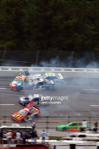 Kyle Busch driver of the MM's Toyota Casey Mears driver of the GEICO Ford Michael Waltrip driver of the Aaron's Dream Machine / Alabama National...