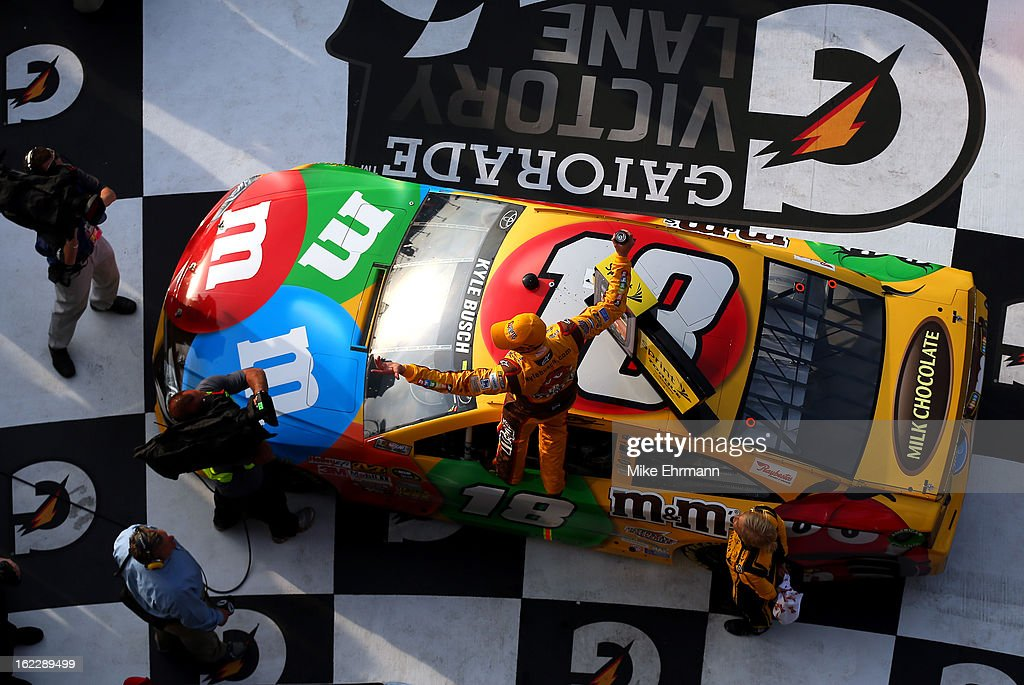 <a gi-track='captionPersonalityLinkClicked' href=/galleries/search?phrase=Kyle+Busch&family=editorial&specificpeople=211123 ng-click='$event.stopPropagation()'>Kyle Busch</a>, driver of the #18 M&M's Toyota, celebrates in Victory Lane after winning the NASCAR Sprint Cup Series Budweiser Duel 2 at Daytona International Speedway on February 21, 2013 in Daytona Beach, Florida.