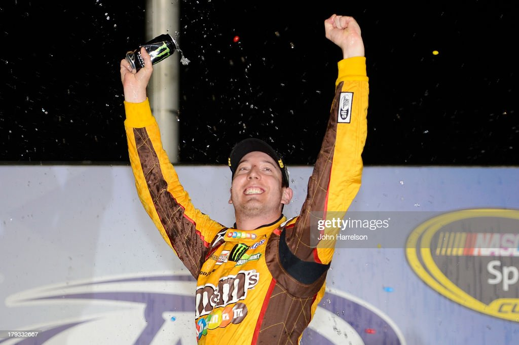 <a gi-track='captionPersonalityLinkClicked' href=/galleries/search?phrase=Kyle+Busch&family=editorial&specificpeople=211123 ng-click='$event.stopPropagation()'>Kyle Busch</a>, driver of the #18 M&M's Toyota, celebrates in victory lane after winning the NASCAR Sprint Cup Series AdvoCare 500 at Atlanta Motor Speedway on September 1, 2013 in Hampton, Georgia.
