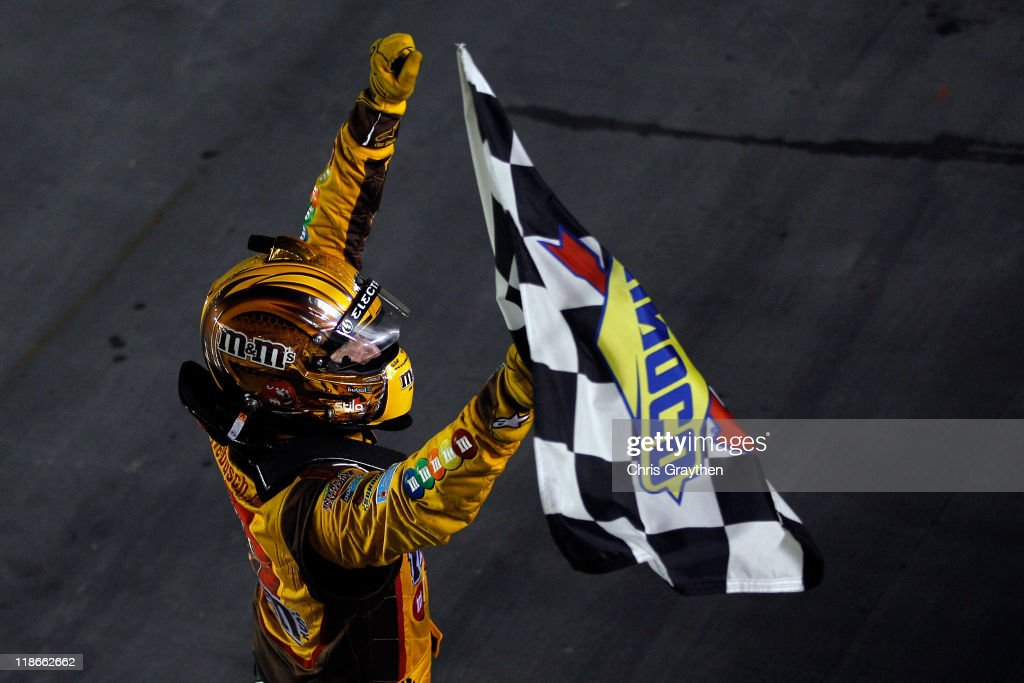<a gi-track='captionPersonalityLinkClicked' href=/galleries/search?phrase=Kyle+Busch&family=editorial&specificpeople=211123 ng-click='$event.stopPropagation()'>Kyle Busch</a>, driver of the #18 M&M's Toyota, celebrates with the checkered flag after winning the NASCAR Sprint Cup Series Quaker State 400 at Kentucky Speedway on July 9, 2011 in Sparta, Kentucky.