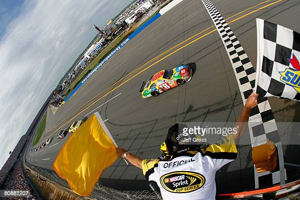 Kyle Busch driver of the MM's Toyota comes to the finish line to win the NASCAR Sprint Cup Series Aaron's 499 at Talladega Superspeedway on April 27...