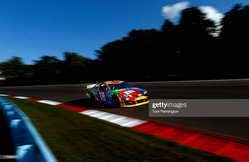 <a gi-track='captionPersonalityLinkClicked' href=/galleries/search?phrase=Kyle+Busch&family=editorial&specificpeople=211123 ng-click='$event.stopPropagation()'>Kyle Busch</a>, driver of the #18 M&M's Toyota, drives during practice for the NASCAR Sprint Cup Series Cheez-It 355 at Watkins Glen International on August 9, 2013 in Watkins Glen, New York.