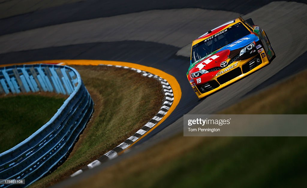 <a gi-track='captionPersonalityLinkClicked' href=/galleries/search?phrase=Kyle+Busch&family=editorial&specificpeople=211123 ng-click='$event.stopPropagation()'>Kyle Busch</a>, driver of the #18 M&M's Toyota, drives during qualifying for the NASCAR Sprint Cup Series Cheez-It 355 at The Glen at Watkins Glen International on August 10, 2013 in Watkins Glen, New York.