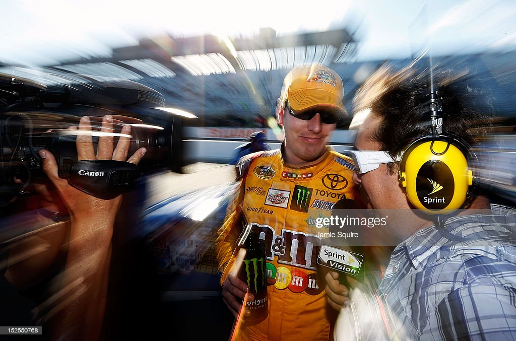 <a gi-track='captionPersonalityLinkClicked' href=/galleries/search?phrase=Kyle+Busch&family=editorial&specificpeople=211123 ng-click='$event.stopPropagation()'>Kyle Busch</a>, driver of the #18 M&M's Toyota, is interviewed on pit road during qualifying for the NASCAR Sprint Cup Series Sylvania 300 at New Hampshire Motor Speedway on September 21, 2012 in Loudon, New Hampshire.