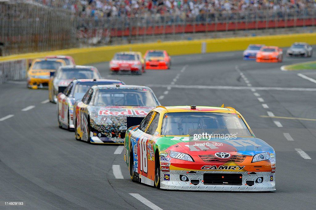 Kyle Busch driver of the MM's Toyota leads a group of cars during the NASCAR Sprint Cup Series CocaCola 600 at Charlotte Motor Speedway on May 29...