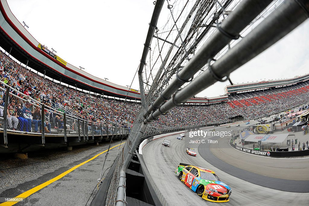 <a gi-track='captionPersonalityLinkClicked' href=/galleries/search?phrase=Kyle+Busch&family=editorial&specificpeople=211123 ng-click='$event.stopPropagation()'>Kyle Busch</a>, driver of the #18 M&M's Toyota, leads a group of cars during the NASCAR Sprint Cup Series Food City 500 at Bristol Motor Speedway on March 17, 2013 in Bristol, Tennessee.