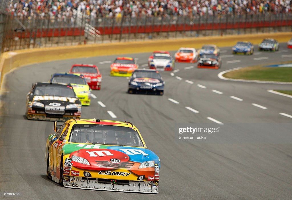 Kyle Busch driver of the MM's Toyota leads a group of cars during the NASCAR Sprint Cup Series CocaCola 600 on May 25 2009 at Lowe's Motor Speedway...