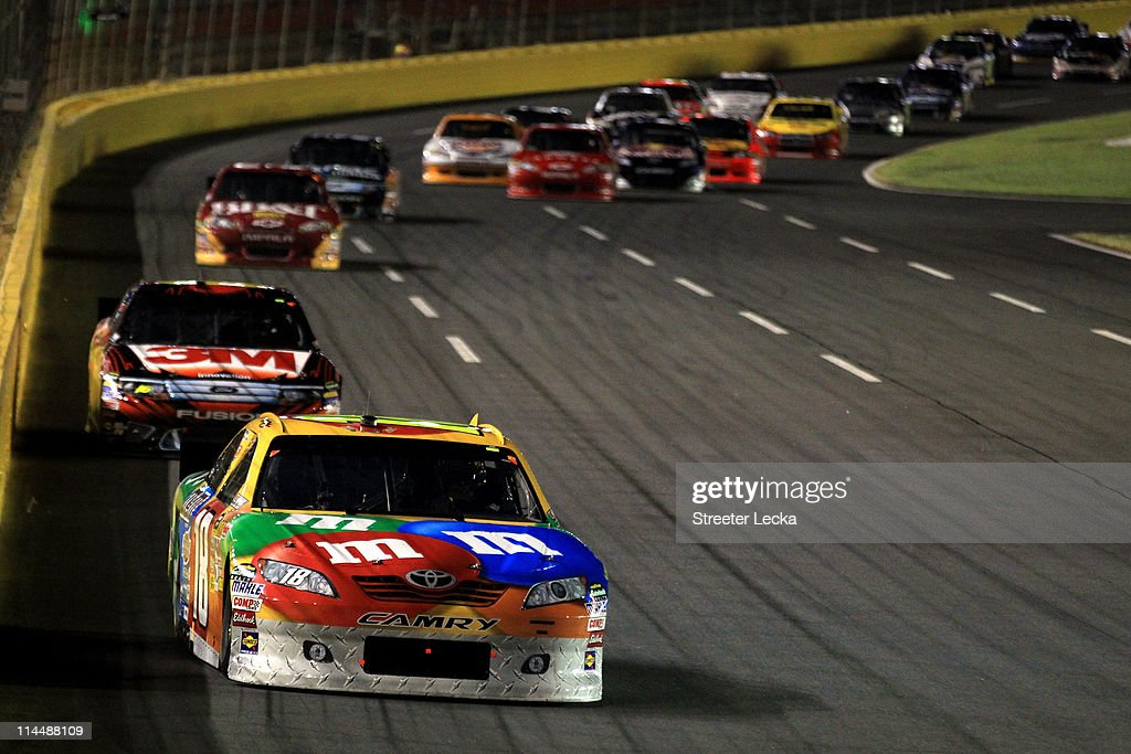 Kyle Busch driver of the MM's Toyota leads a line of cars during the NASCAR Sprint AllStar Race at Charlotte Motor Speedway on May 21 2011 in...