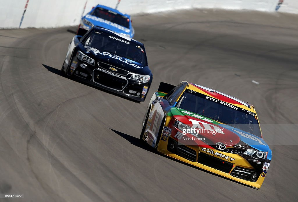 Kyle Busch, driver of the #18 M&M's Toyota, leads Juan Pablo Montoya, driver of the #42 AXE Apollo Chevrolet, and Kasey Kahne, driver of the #5 Farmers Insurance Chevrolet, during the NASCAR Sprint Cup Series Kobalt Tools 400 at Las Vegas Motor Speedway on March 10, 2013 in Las Vegas, Nevada.