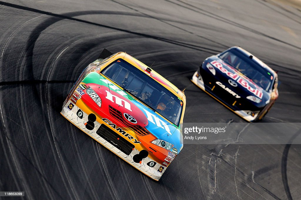 <a gi-track='captionPersonalityLinkClicked' href=/galleries/search?phrase=Kyle+Busch&family=editorial&specificpeople=211123 ng-click='$event.stopPropagation()'>Kyle Busch</a>, driver of the #18 M&M's Toyota, leads <a gi-track='captionPersonalityLinkClicked' href=/galleries/search?phrase=Kasey+Kahne&family=editorial&specificpeople=183374 ng-click='$event.stopPropagation()'>Kasey Kahne</a>, driver of the #4 Red Bull Toyota, during the NASCAR Sprint Cup Series Quaker State 400 at Kentucky Speedway on July 9, 2011 in Sparta, Kentucky.
