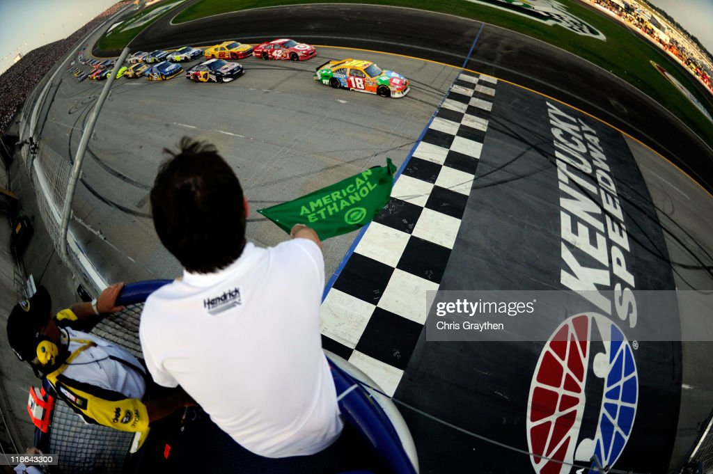 <a gi-track='captionPersonalityLinkClicked' href=/galleries/search?phrase=Kyle+Busch&family=editorial&specificpeople=211123 ng-click='$event.stopPropagation()'>Kyle Busch</a>, driver of the #18 M&M's Toyota, leads the field to the green flag to start the NASCAR Sprint Cup Series Quaker State 400 at Kentucky Speedway on July 9, 2011 in Sparta, Kentucky.