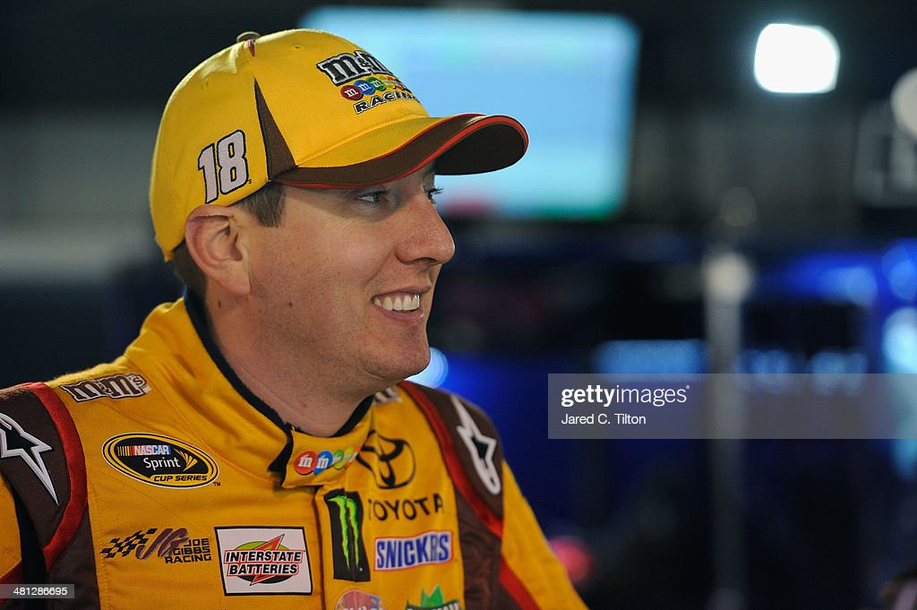 <a gi-track='captionPersonalityLinkClicked' href=/galleries/search?phrase=Kyle+Busch&family=editorial&specificpeople=211123 ng-click='$event.stopPropagation()'>Kyle Busch</a>, driver of the #18 M&M's Toyota, looks on in the garage area during a rain delay in practice for the NASCAR Sprint Cup Series STP 500 at Martinsville Speedway on March 29, 2014 in Martinsville, Virginia.