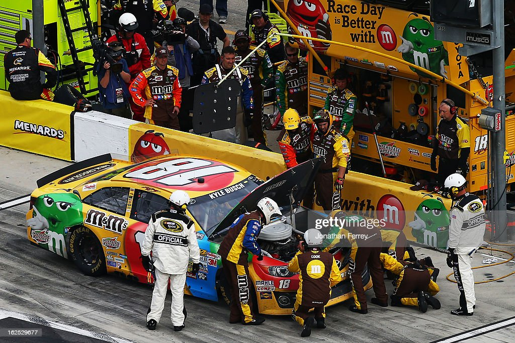 Kyle Busch, driver of the #18 M&M's Toyota, pits after a malfunction during the NASCAR Sprint Cup Series Daytona 500 at Daytona International Speedway on February 24, 2013 in Daytona Beach, Florida.