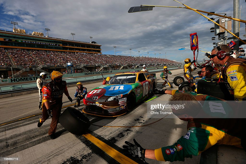 Kyle Busch, driver of the #18 M&M's Toyota, pits during the NASCAR Sprint Cup Series Ford EcoBoost 400 at Homestead-Miami Speedway on November 18, 2012 in Homestead, Florida.