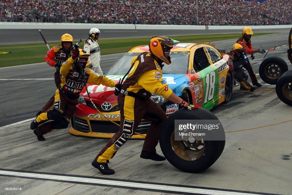 Kyle Busch, driver of the #18 M&M's Toyota, pits during the NASCAR Sprint Cup Series Daytona 500 at Daytona International Speedway on February 24, 2013 in Daytona Beach, Florida.